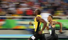 Jamaica's Usain Bolt and Canada's Andre De Grasse smile as they compete in the 200m semi-finals. Rio 2016