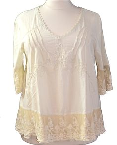 Gretty Zueger Natural LinenTop  Gorgeous natural Peruvian cotton top with pleat detail, embroidery and netting lace. The elbow length sleeves are accented with coordinating netting lace. The amazing details make this top a perfect match for jeans or denim shorts.  2X, 3X