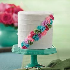 Fresh Floral Cake - Fondant is tinted in six hot fashion colors, then shaped into tufts to create a swash of brilliant texture across your cake! Wilton Cakes, Wilton Fondant, Bolo Floral, Floral Cake, Beautiful Cakes, Amazing Cakes, Mini Cakes, Cupcake Cakes, Deserts