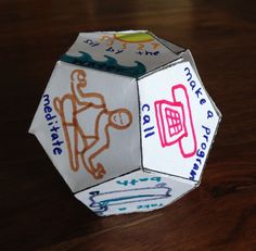 We will be creating a 12-sided dice.  On each of the sides, you will write or draw something representing a tool of the program.  Then, w...