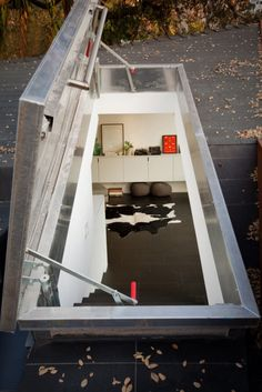 roof hatch door at Manifold House designed by ANX / Aaron Neubert Architects Interesting Buildings, Beautiful Buildings, Roof Hatch, Hatch Door, Gaudi, Garages, Roof Design, House Design, Types Of Roofing Materials