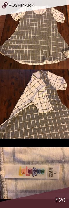 LuLaRoe Perfect T - grey and white large check Grey and White LuLaRoe Perfect T. Worn a few times - t just not for me. Washed and hung to try as per directions. Grey with white large checks on the front, and white with grey large checks. Smoke free home. LuLaRoe Tops Tees - Short Sleeve