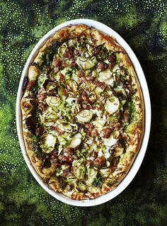 Deep-Dish Pizza With Turkey Sausage and Brussels Sprouts | Get the recipe for Deep-Dish Pizza With Turkey Sausage and Brussels Sprouts.