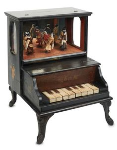 miniature porcelain pianos | ... miniature porcelain dolls. When the keys are played, a mechanism