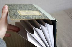 Love these storage folders made from old books (can sit right back on the bookshelf)