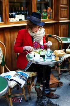 From The Sartorialist. I love everything she's wearing.  She looks like the Mad Hatter's stylish sister.