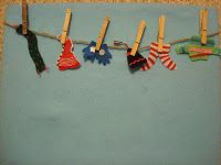 "Retell or sequence ""The Hat"" by Jan Brett using small clothing with clothespins and a rope or piece of yarn"