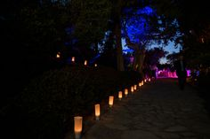 Cobbled path lit up with white candle bags at Mallorca Wedding 2016, Wedding planning and production by Undercover Events. Undercover Events, wedding & event planners in Mallorca.