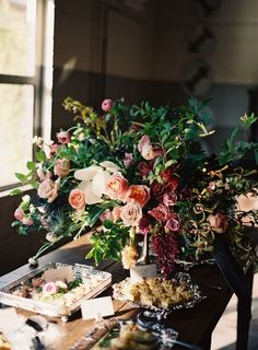 Natural but lush and abundant. Roses in unusual shades with lots of interesting greenery