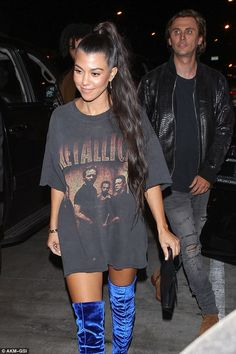 Hottie:Kourtney was dressed to impress in a Metallica shirt and over the knee blue velvet boots