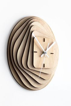 The clock consists of 11 laser cut birch plywood parts with 7 main layers with space between them and 4 construction parts that are also cleverly used as a main hour dial.The layers are forming transformation from outer circular shape to inner s… Cool Clocks, Unique Wall Clocks, Diy Wall Clocks, Clock Wall, Deco Design, Wood Design, Design Design, Diy Clock, Clock Ideas