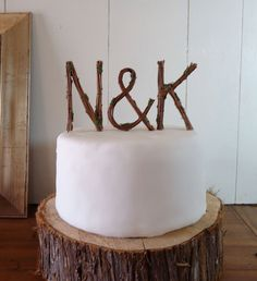 Rustic Wedding Cake Topper - Any Two Vine Letters with Ampersand. $56.00, via Etsy.
