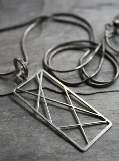 Steel Criss-Cross Charm Necklace.  I really like this!!