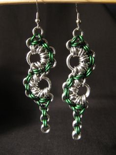 These chainmaille earrings are made from green anodized aluminum and silver aluminum jump rings. From the top ring to the bottom they measure 1.5