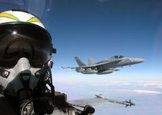 Navy Hornet Pilot Flys Support Mission  INFLIGHT - APRIL 11: In this handout photo from the U.S. Navy, two Hornet warplanes fly close air support missions for coalition special operation forces involved in the U.S.-led war in Iraq April 11, 2003 over the Mediterranean Sea. The planes launched from the USS Truman and Carrier Air Wing Three conducting combat missions in support of the war. (Photo Tom Lalor/U.S. Navy/Getty Images)