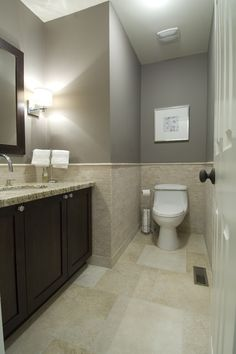 Long-Wooden-Vanity-with-Granite-Countertop-White-Sink-Wide-Mirror-Grey-Wall-and-Brown-Tile-Floor.jpg 426×640 pixels