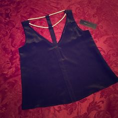 BCBGMAXAZRIA Silk Top Shell: 100% silk. Lining: 100% polyester. Black sleeveless top with collarbone golden chain. New with tags. Pairs nicely with bandage BCBG skirt that has been listing on Poshmark as well. BCBGMaxAzria Tops Tank Tops