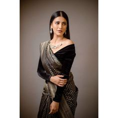 In a black color saree and velvet off shoulder full sleeve blouse design Full Sleeves Blouse Designs, Black Blouse Designs, Sari Blouse Designs, Saree Blouse Patterns, Designer Blouse Patterns, Off Shoulder Saree Blouse, Velvet Saree, Saree Jackets, Saree Hairstyles