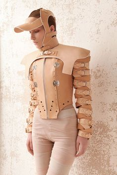 Orthopedic practices to correct body deformities influenced the leather straps and buckles in this fashion collection