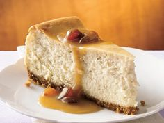 This sounds Yummy!! Hot Buttered Rum Cheesecake with Brown Sugar-Rum Sauce
