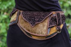 Golden Waves Festival Pocket Belt Utility belt by Sandalamoon, $148.00 I would do some fancy bead work and that might make it a little more appealing to myself.