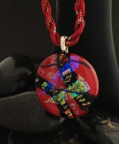 Reddish Dichroic Glass Pendant with  a matching Handmade Cord. - $55.21 USD