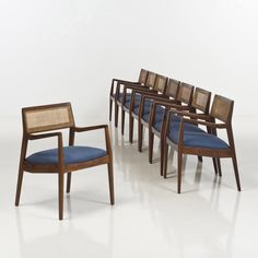 Jens Risom; #C140 Walnut and Cane 'Playboy' Armchairs, c1960.