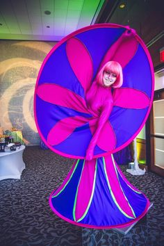 Pink and purple spiral diva living art for a cirque themed event, Houston entertainment agency, J&D Entertainment www.jdentertain.com Breast Cancer Awareness, Spiral, Divas, Purple, Pink, Houston, Whimsical, Valentines, Entertainment