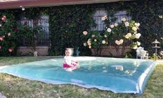 Make your own outdoor see through water bed for kids to play on. Definitely doing this this summer!