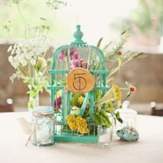 For a spring time touch add some bird cages to your wedding's decor.