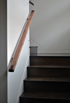Walnut & Steel Handrail, connecting hardware buried in wall. Thanks again to our friends at Mark Ashby Design for working with us. Banister Rails, Diy Stair Railing, Staircase Railing Design, Banisters, Wall Mounted Handrail, Flagstaff House, Steel Handrail, House Stairs, Home Upgrades