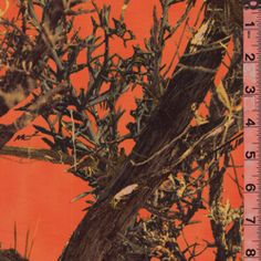"Truetimber MC2 Blaze Orange     DF#VY1009      MC2 (Mixed Concealment  Camouflage) TrueTimber  Camouflage Coated  Canvas Fabric  600 Denier  Water Resistant  100% Nylon  58/60"" Wide  This is the perfect pattern  for all open settings. The  photographic elements of  grass, sage, brush, rock,  and open ground in MC2  give it the versatility to  be effective in all settings.  Same pattern as VY1002  & VY1011, but with Blaze  Orange background  $13.45 per yard"