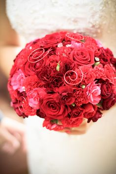 bridal bouquet with red roses and gillyflowers
