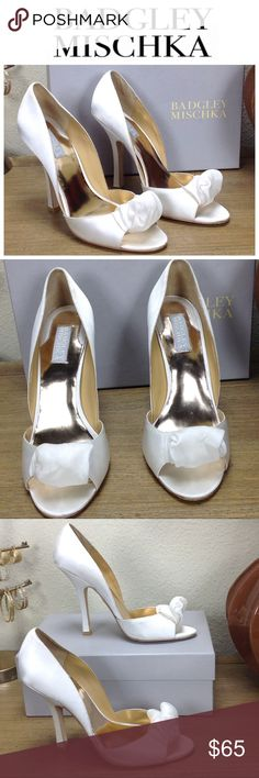 Badgley Mischka White Satin Open Toe Stilettos Stunning white satin open toe stilettos that will make people stop and stare. With sheer white embellishments at the toes and satin covered 5 inch stiletto heels these shoes will make a statement. They run approximately a half size small and come with the original box. Some spots (see pics) but they are difficult to see. Thanks for your interest!  Please checkout the rest of my closet. Badgley Mischka Shoes Heels