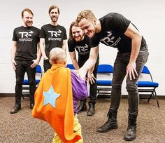 Imagine Dragons comforting boy with cancer. :) it's good to know that there's still good people in world.
