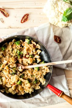 Pasta with Broccoli and Cauliflower Recipe - Pasta with broccoli & cauliflower, subtly flavored by sun dried tomatoes & with plenty protein from beans!