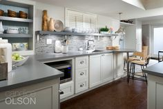 Sleek, granite-look countertops give this family lots of space for fixing snacks and drinks and even for serving a buffet when crowds of friends come over. #candiceolson #basement
