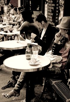 Cafe' Life , Paris.  They all face out.  Bold faced staring and people watching is an art in France.