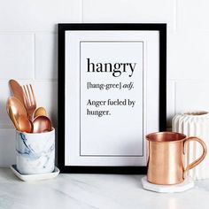 Celebrate your favorite slang with this humorous hangry word definition wall art from Fuzzy and Birch. Set against a white background, the text is situated like an original dictionary page with a black outline. Considered the most feared state around, the hangry person is enraged by their hunger.  Give guests and visitors a reason to do a double-take when visiting your home. Frame it and hang it anywhere in your home that could use a measure of wittiness. Also makes a perfect gift for…