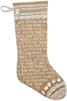 """This lovely Christmas stocking has a charming design with button accents and vintage inspired lace over burlap. The body of the stocking features the words JOY TO THE WORLD repeated over and over. Made by Primitives by Kathy this beautiful Christmas stocking measures 19"""" tall by 9.5"""" wide. Joy Christmas Stocking by Primitives by Kathy. Home & Gifts - Home Decor - Holiday Boulder Colorado"""