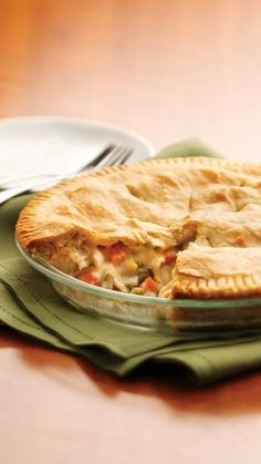 Classic Chicken Pot Pie Recipe - Check out this budget-friendly take on the classic recipe complete with chicken, mixed vegetables, a rich homemade white sauce and a flaky pie crust.