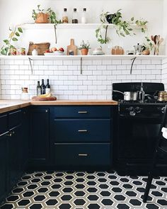 Really wishing my kitchen looked like this right now... I know it's hiding somewhere under all those dishes, blenders and random toys.