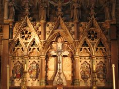 The Altar Cross is flanked by mosaics with symbols of the four Evangelists.