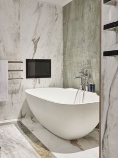 A stunning custom bathtub design big enough for two. This hotel bathroom is elegant and luxurious. Great inspiration for your master bathroom design. #masterbathroom #hotelbathroom