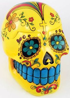 Day of the Dead skull is actually a box. The top pops off. Clever! I have seen these in black, white, red, and blue as well.