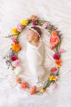 Newborn in a flower wreath