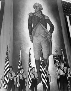 Members of the pro-Nazi German American Bund stand before a massive portrait of George Washington at their rally in Madison Square Garden, NYC, 1939