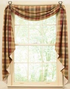 i love the idea of draping my kitchen curtains like this.
