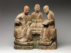 Three Arhats (Luohans)Period: Ming dynasty (1368–1644) Date: 16th–17th century Culture: China Medium: Wood (willow) with traces of pigment and gilding, single-woodblock construction Dimensions: H. 22 1/4 in. (56.5 cm); W. 22 in. (55.9 cm); D. 7 in. (17.8 cm) Classification: Sculpture Credit Line: Purchase, Gifts from various donors, in honor of Douglas Dillon, 1995 Accession Number: 1995.417 Met