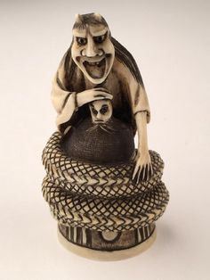 A carved netsuke of a devil. Signed. Height 2 1/2 : Lot 0271